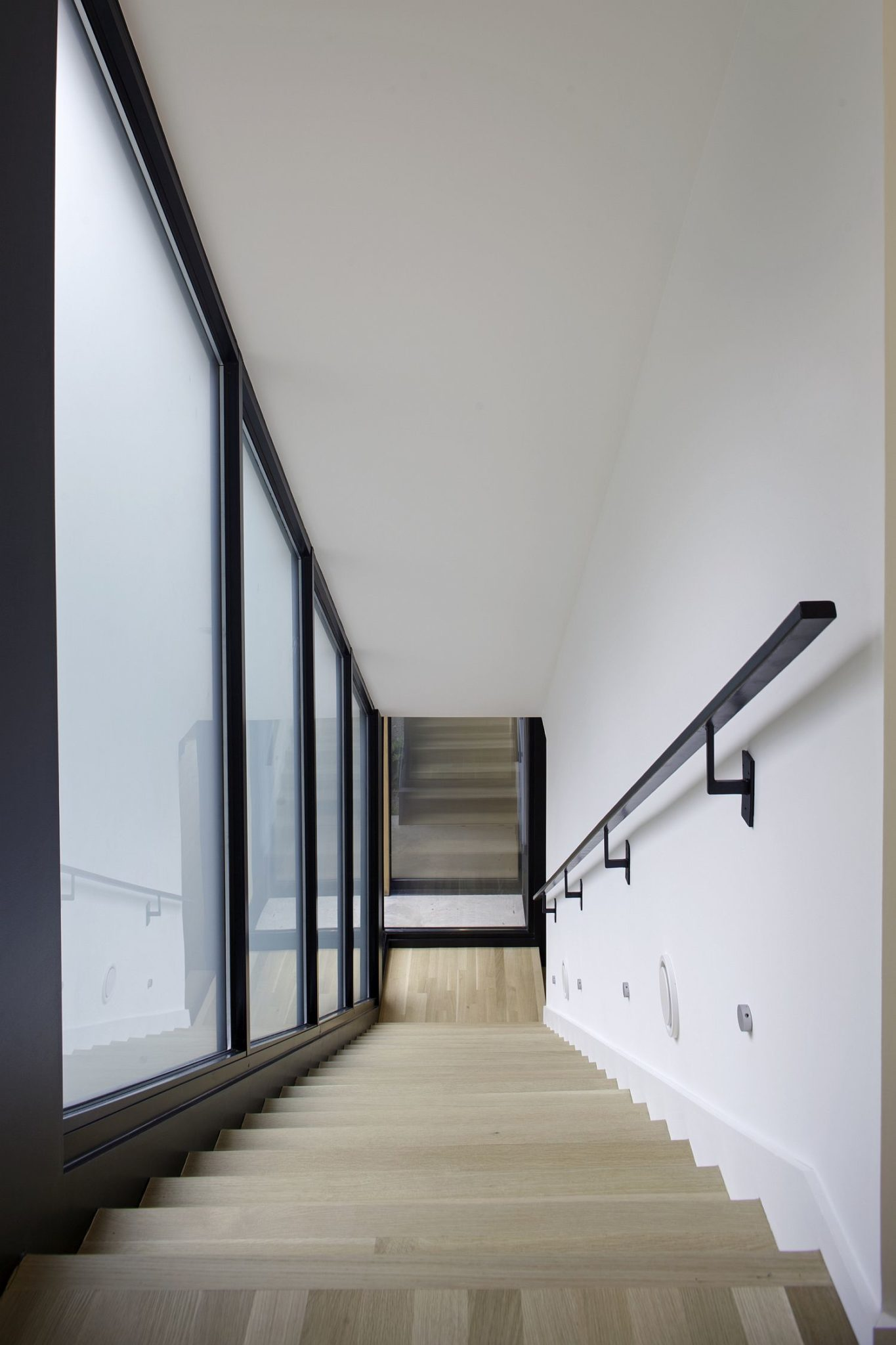 Light-filled staircase connects the various levels of the house