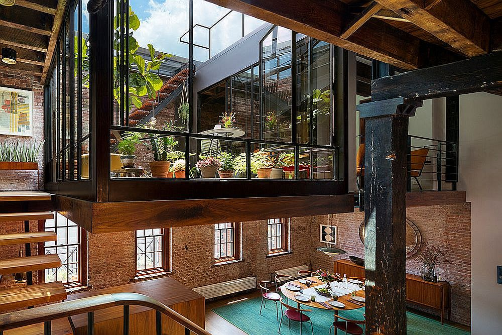 Mezzanine level turned into an industrial sunroom inside a Tribeca Loft