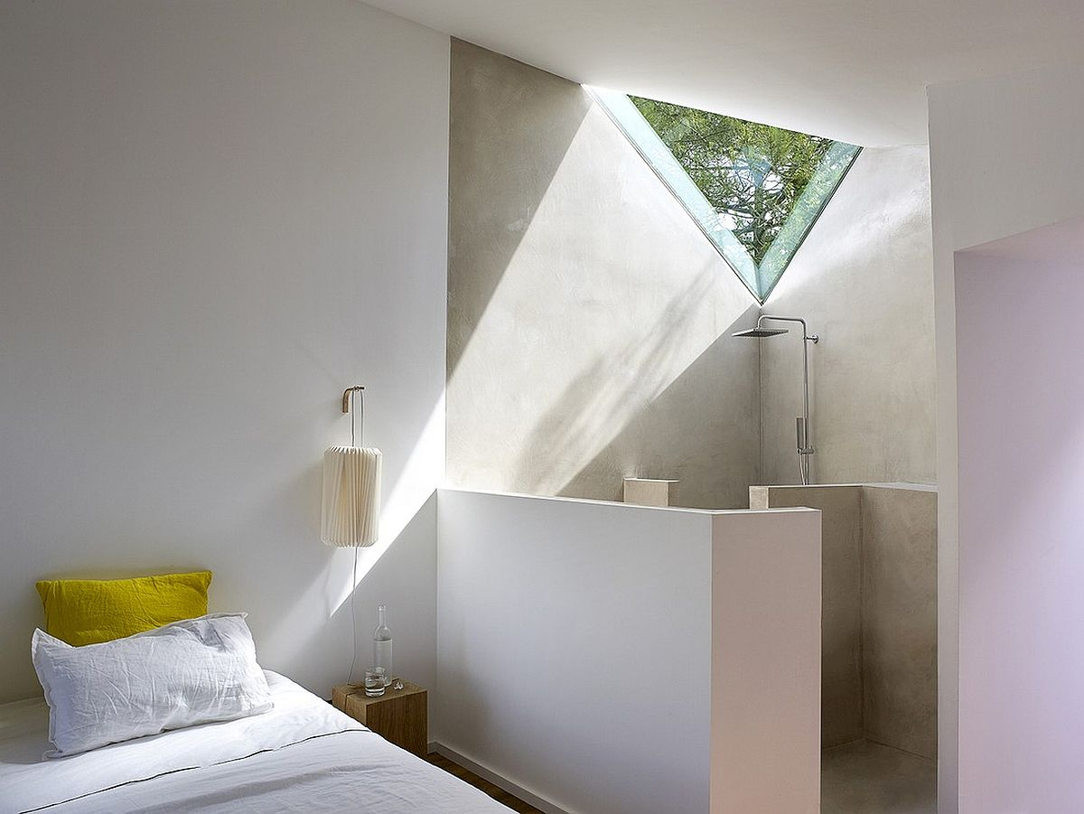 Minimal bedroom with shower area in the corner in white
