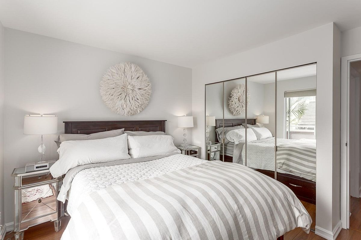 Mirrored-nighstands-and-wardrobe-doors-give-the-bedroom-a-more-spatial-look