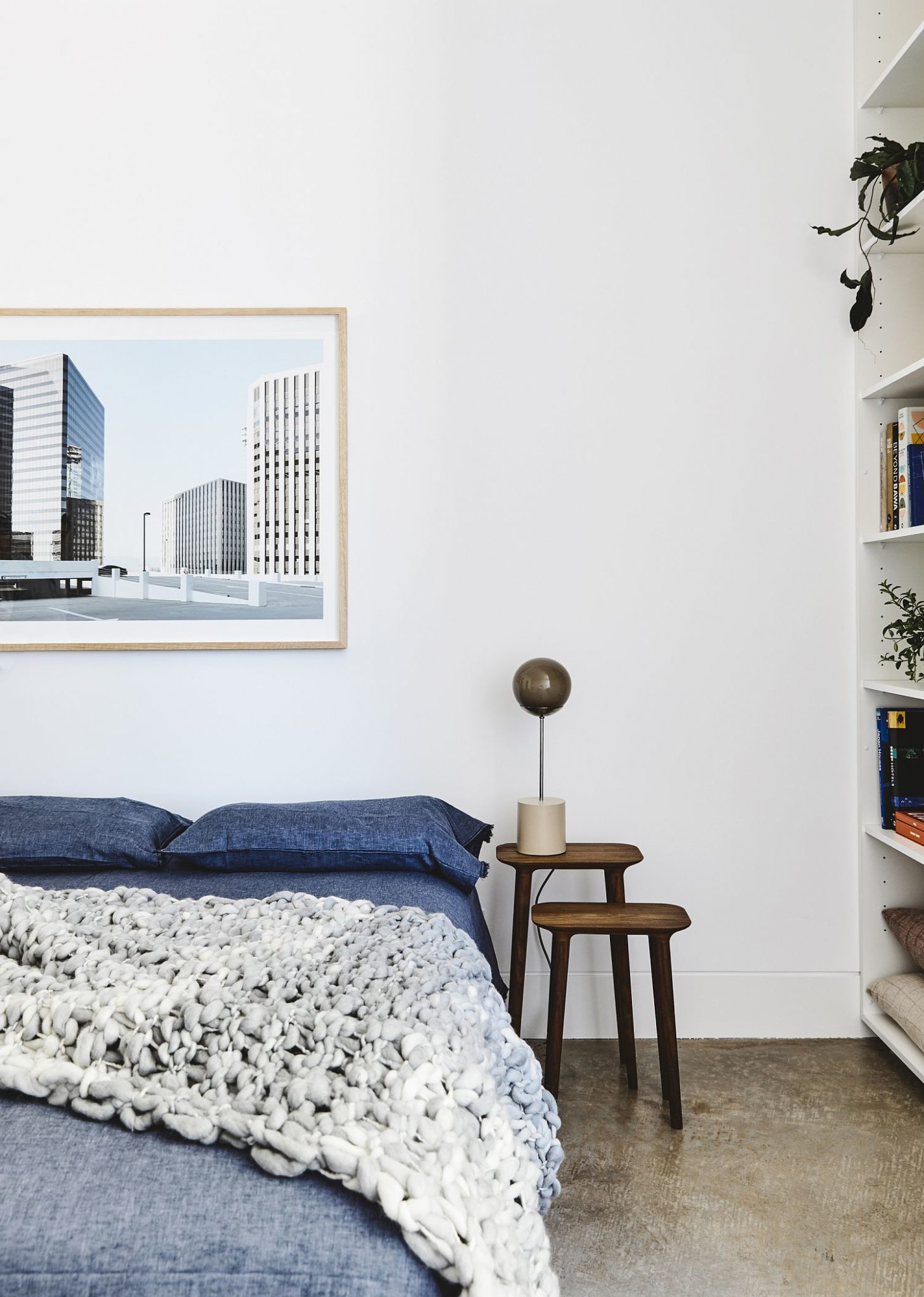 Modern bedroom in white with pops of blue