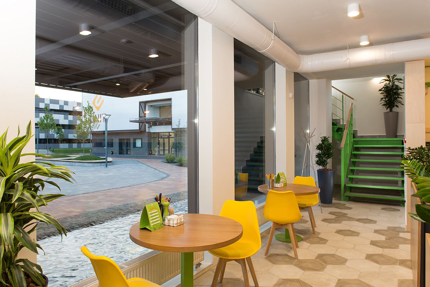 Modern industrial elements along with bright color shape the cafe interior
