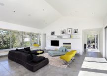 Modern living room of HIllside home with pops of yellow 217x155 Hillside Modern: Charming Family Home Designed for Outdoor Living