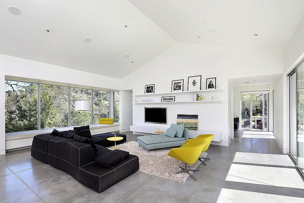 Modern living room of HIllside home with pops of yellow
