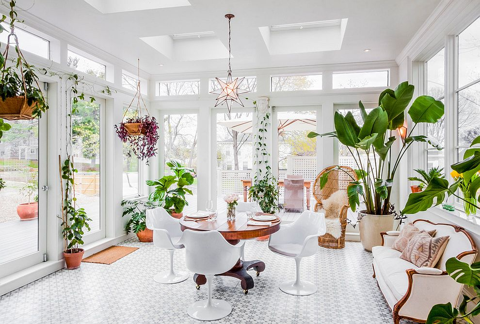 Modern sunroom in white with a variety of indoor plants