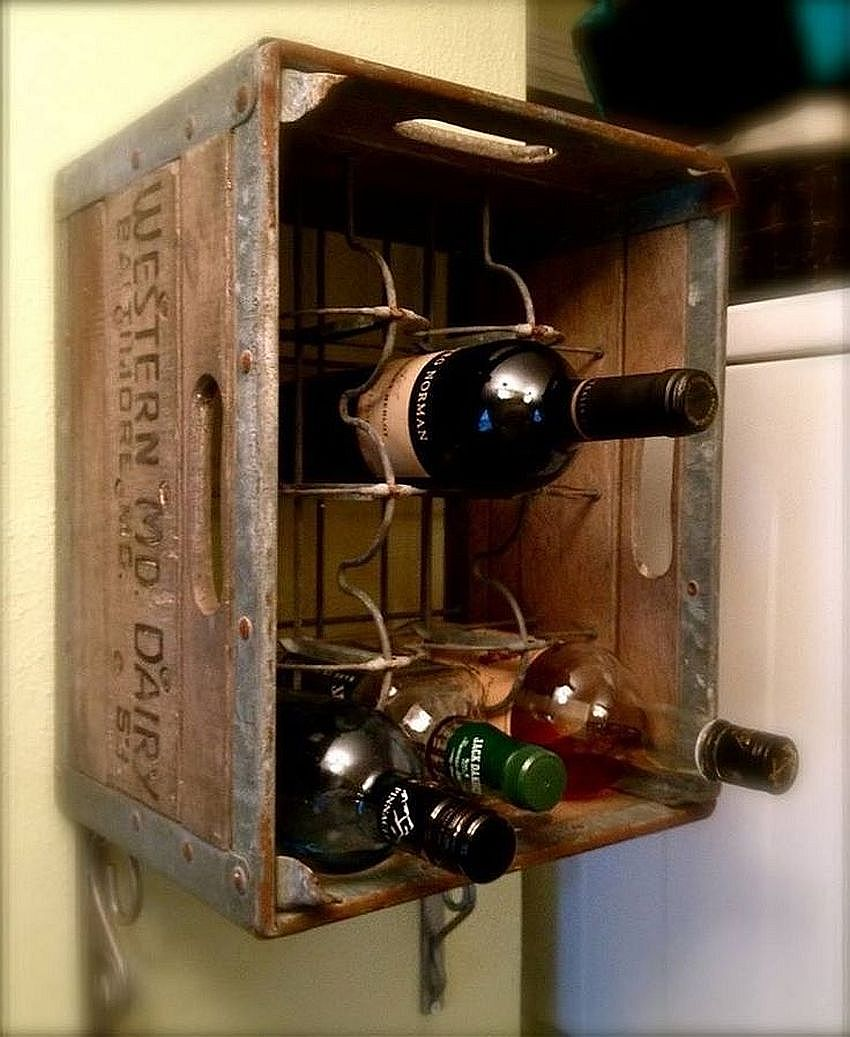 Old wooden crate upcycled into a gorgeous wine rack