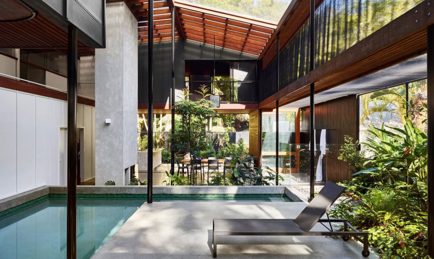 Screened Veranda Walled by a Rainforest Serves as a Serene Holiday Home