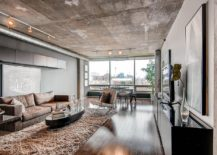 concrete ceiling accented by open ductwork and pipes