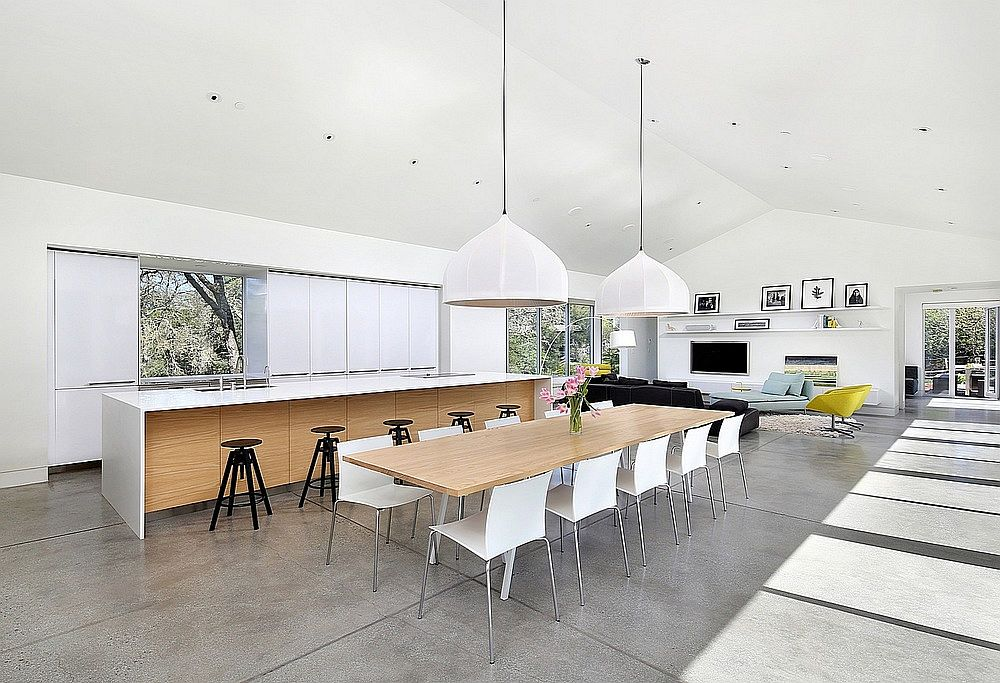Open living area, kitchen and dining of Hillside Modern Residence