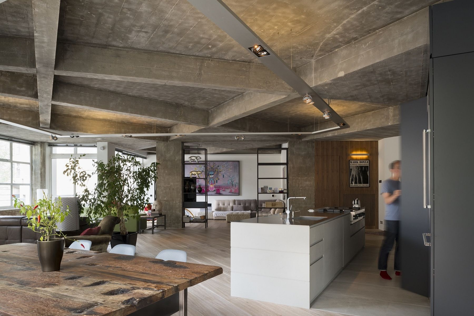Open plan living area of refurbished London Loft with concrete ceiling