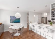 Open-plan-living-area-with-kitchen-and-dining-inside-the-Vancouver-condo-217x155