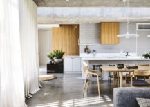 Polished-and-light-filled-dining-area-and-kitchen-of-the-Melbourne-home-217x155