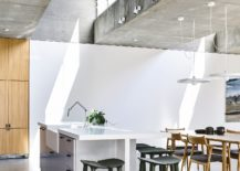 Polished-concrete-floor-and-exposed-concrete-ceilings-give-the-interior-a-minimal-appeal-217x155
