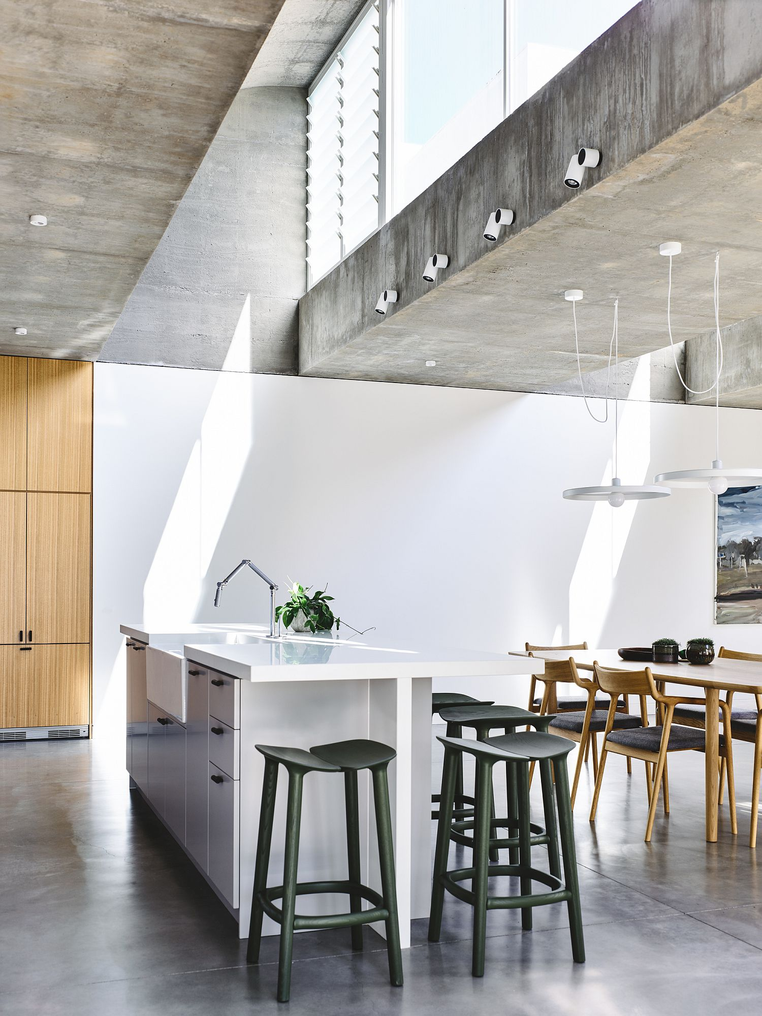 Polished concrete floor and exposed concrete ceilings give the interior a minimal appeal