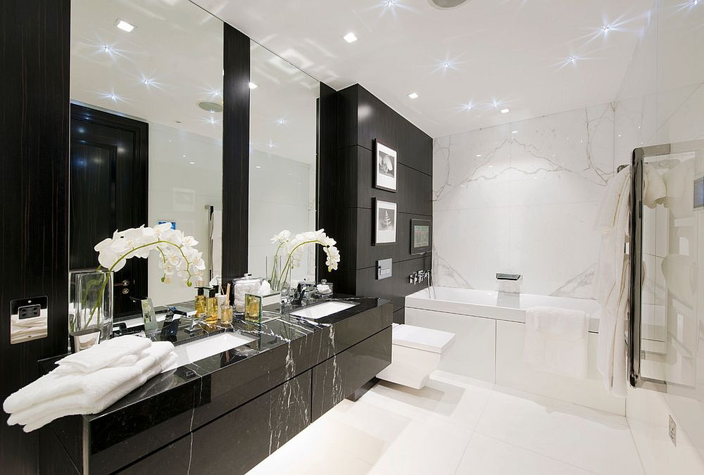Polished floating vanity in black brings contemporary dazzle to bathroom in white