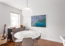 Round-marble-dining-table-with-trendy-chairs-217x155