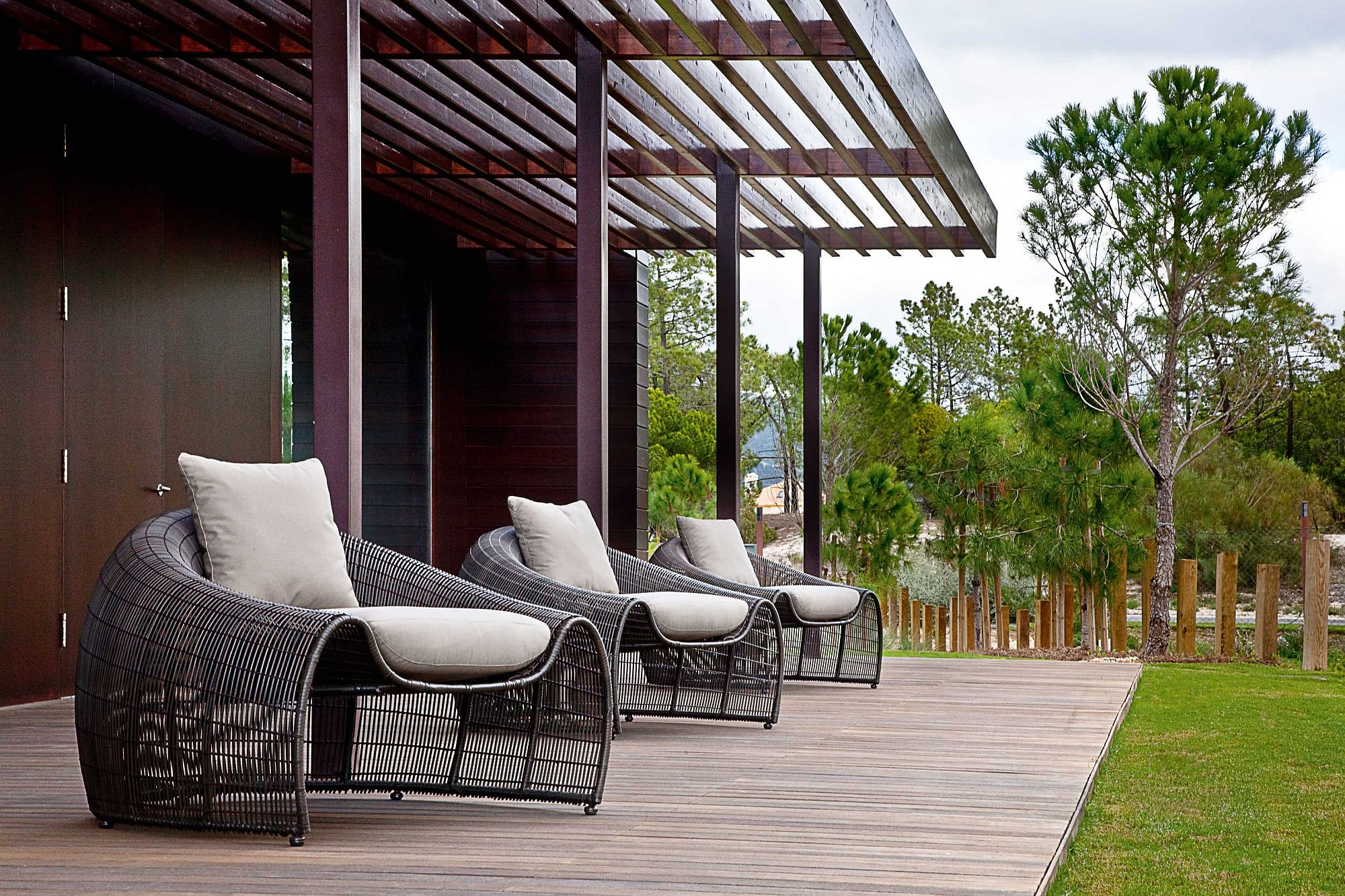 Series of Croissant easy chairs for the large wooden deck