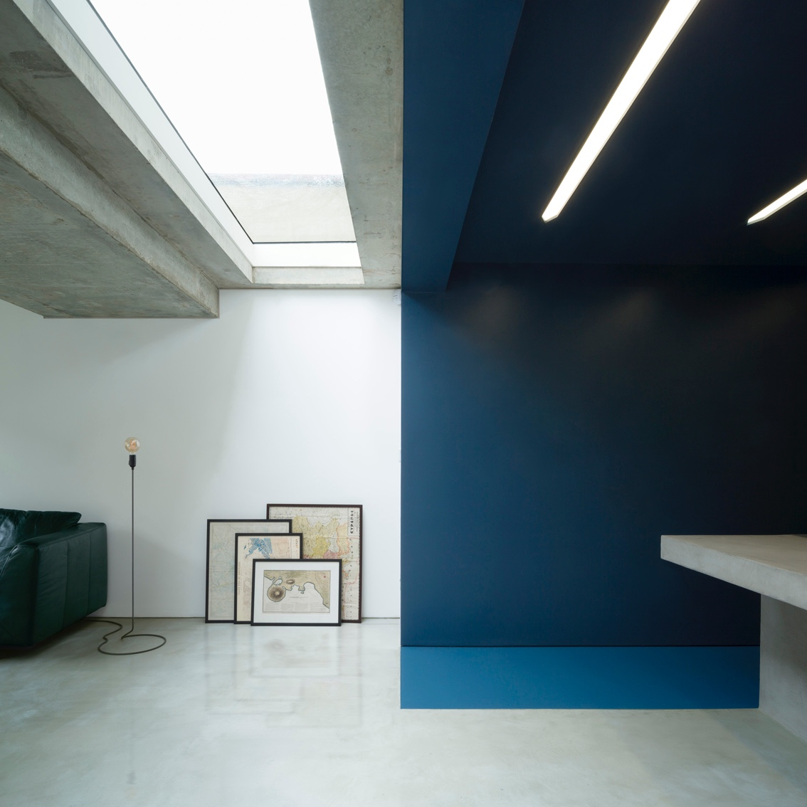 Blue defines both the living space and kitchen