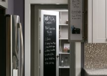 Small-craftsman-style-kitchen-with-pantry-that-fetaures-a-chalkboard-door-217x155