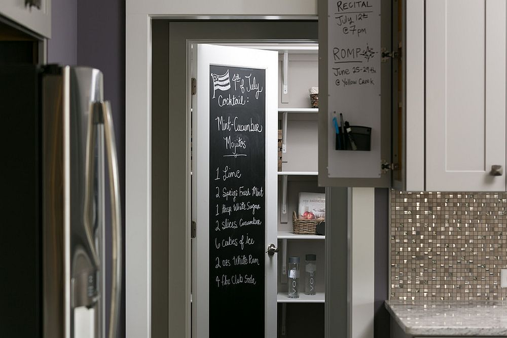 Small-craftsman-style-kitchen-with-pantry-that-fetaures-a-chalkboard-door