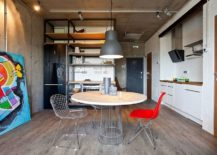 table with two chairs and concrete ceiling