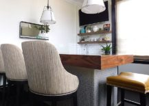 The Bar And Kitchen Area Is Pretty Simple In Its Design With A Modest Brown  Sectional Shaping The Sitting Zone. A Colorful Rug Adds Pattern To This  Space ...