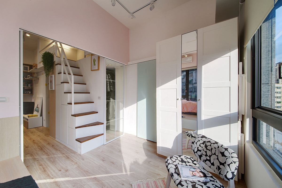 Smart shelving and loft bedroom with storage underneath transform the small apartment