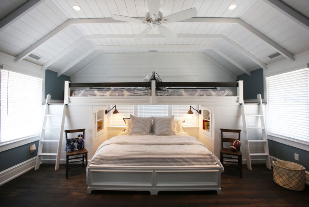 Space-savvy bedroom with loft sleeping nook in the attic