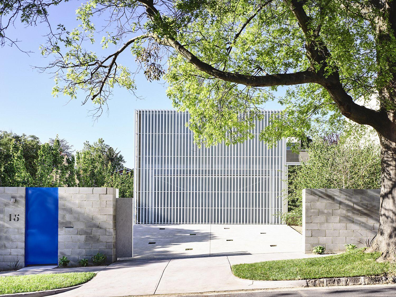 White Aluminum Screen And In Situ Concrete Create A