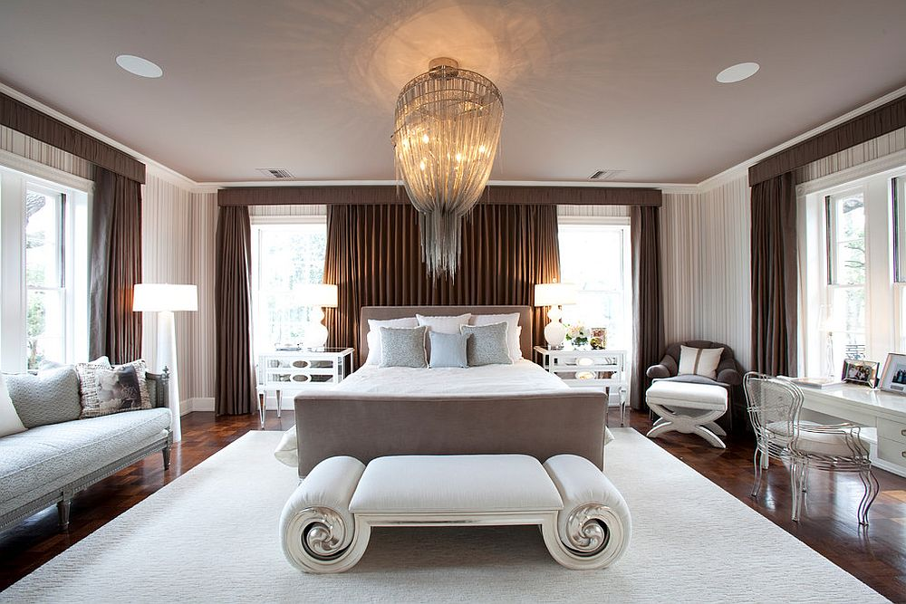 Stunning-chandelier-sits-at-the-center-of-the-expansive-contemporary-bedroom