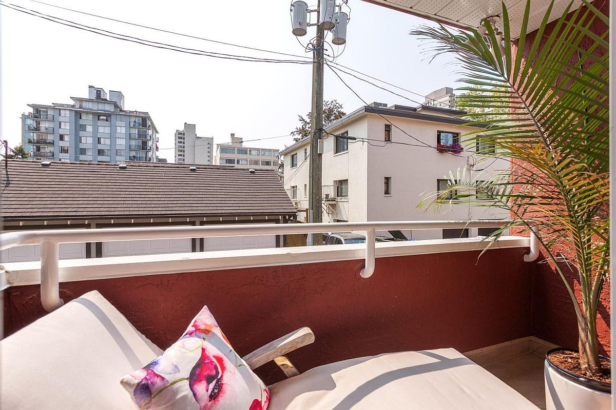 Tiny-bedroom-balcony-with-a-comfy-recliner