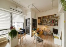 Tiny-dining-space-and-kitchen-next-to-small-living-area-in-the-corner-217x155