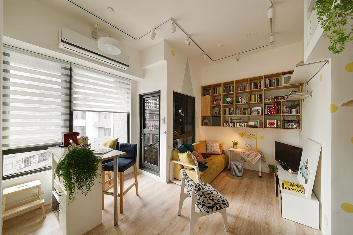 Tiny-dining-space-and-kitchen-next-to-small-living-area-in-the-corner