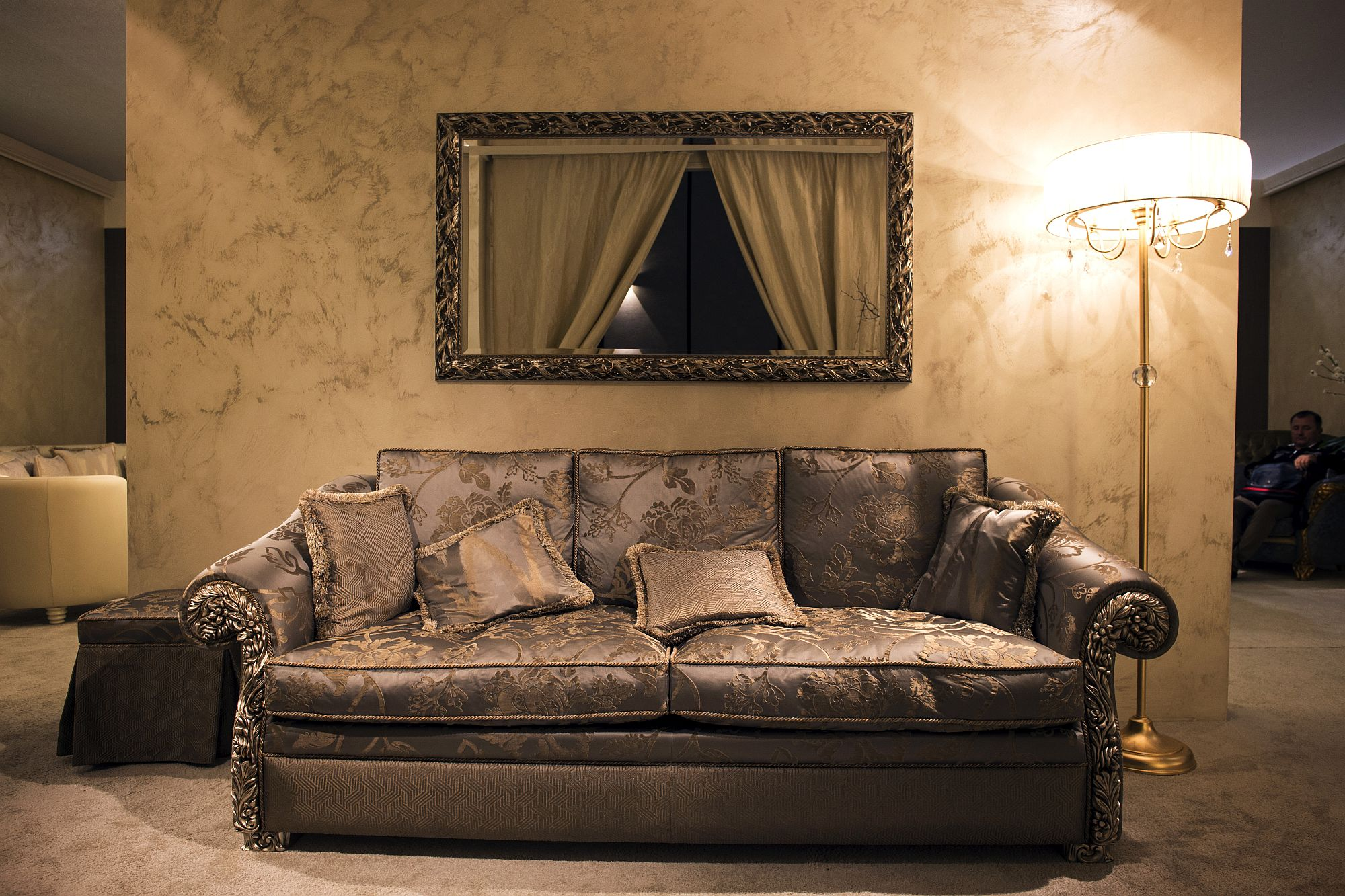 Traditional sofa and floor lamp bring luxurious and timeless charm to the interior