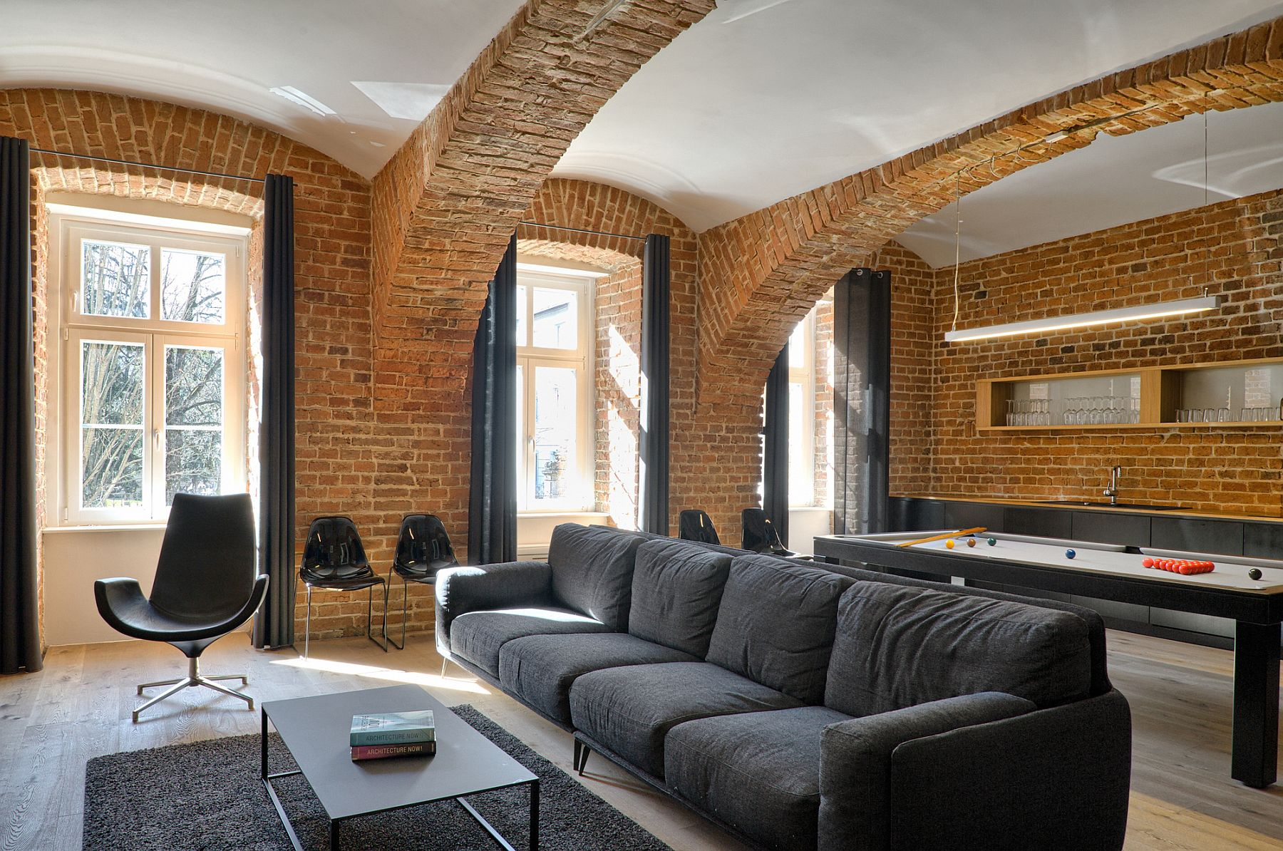 Traditional wooden framed windows bring natural light into the apartment