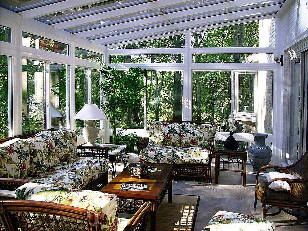 Tropical-sunroom-is-drenched-in-green-without-an-overload-of-indoor-plants