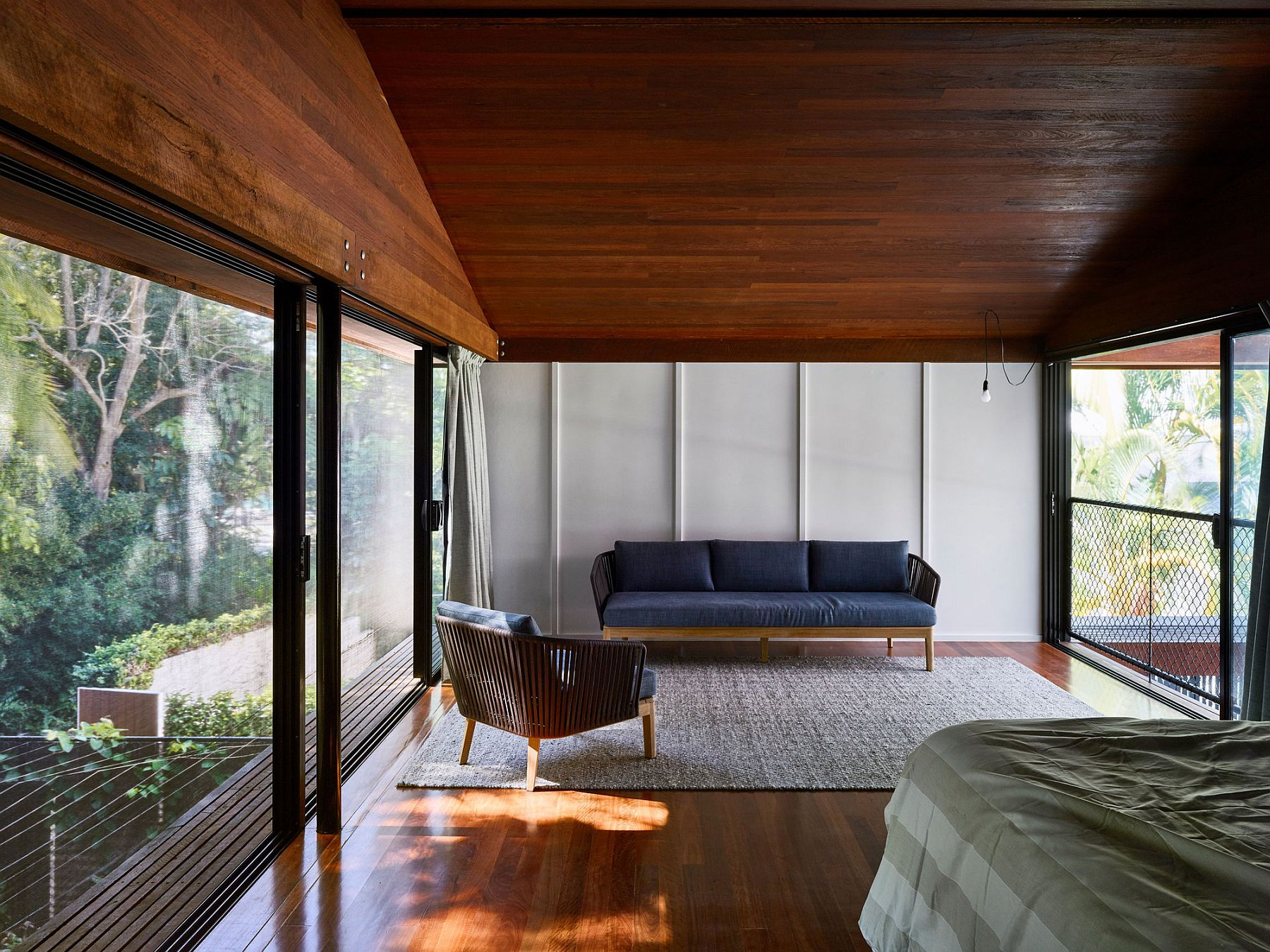 Upper level bedrooms with a view of the rainforest