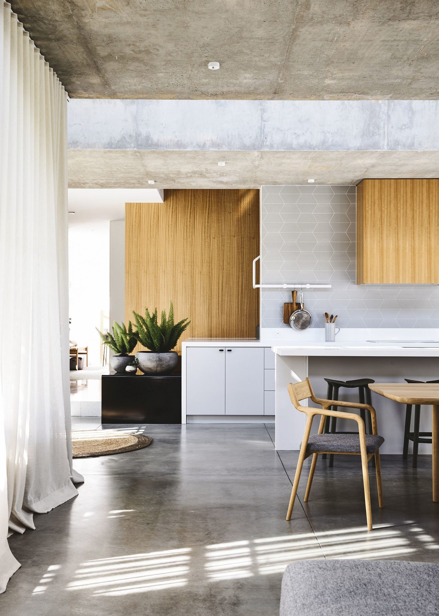 Wood brings a touch of warmth to the interior draped in concrete
