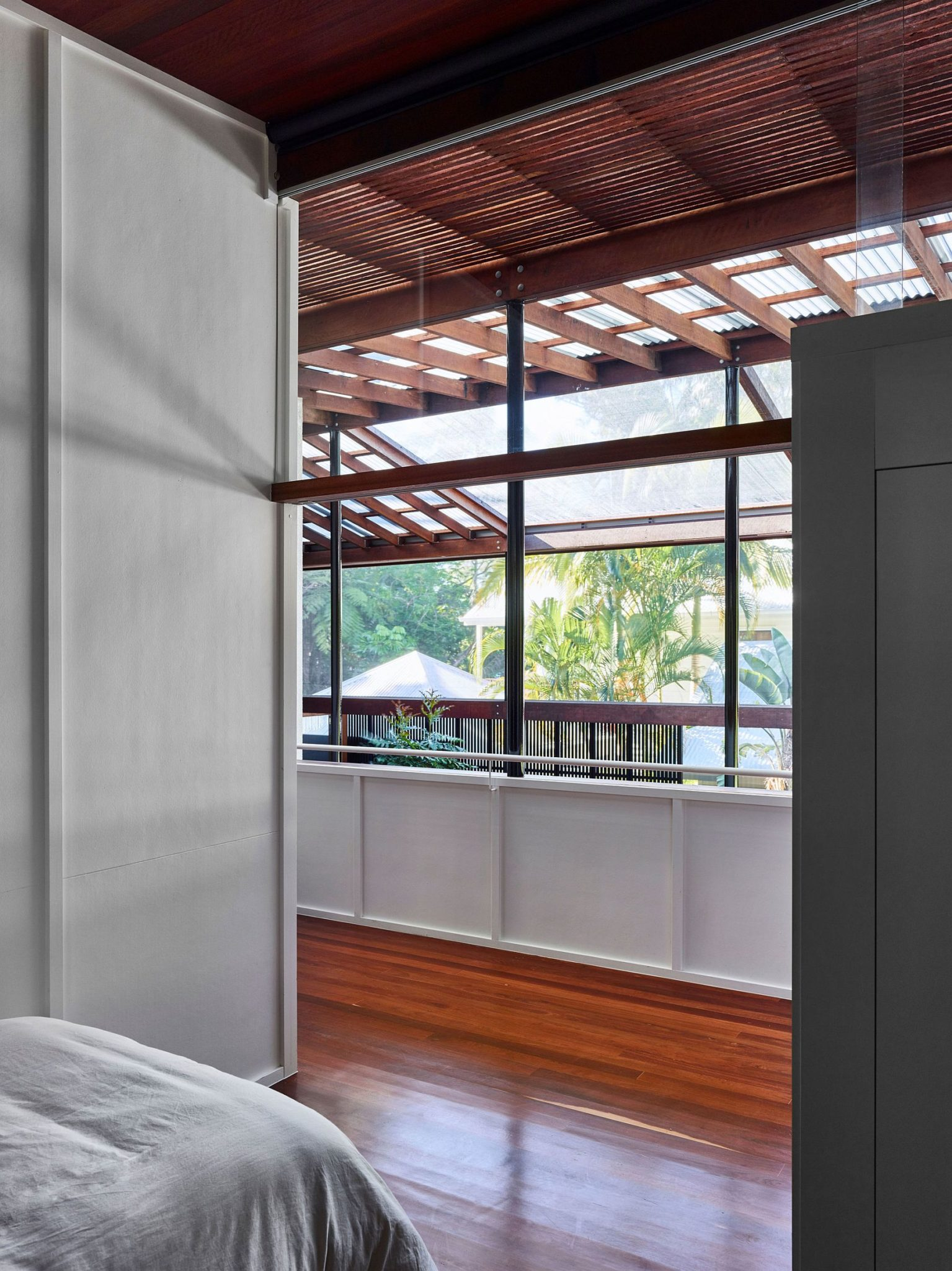 screened veranda walled by a rainforest serves as a serene holiday