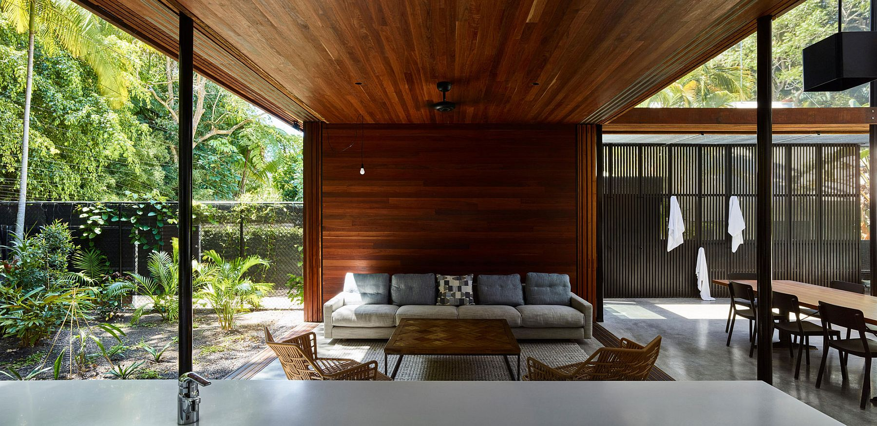 Wooden patio inside the verandah style home set in a Rainforest