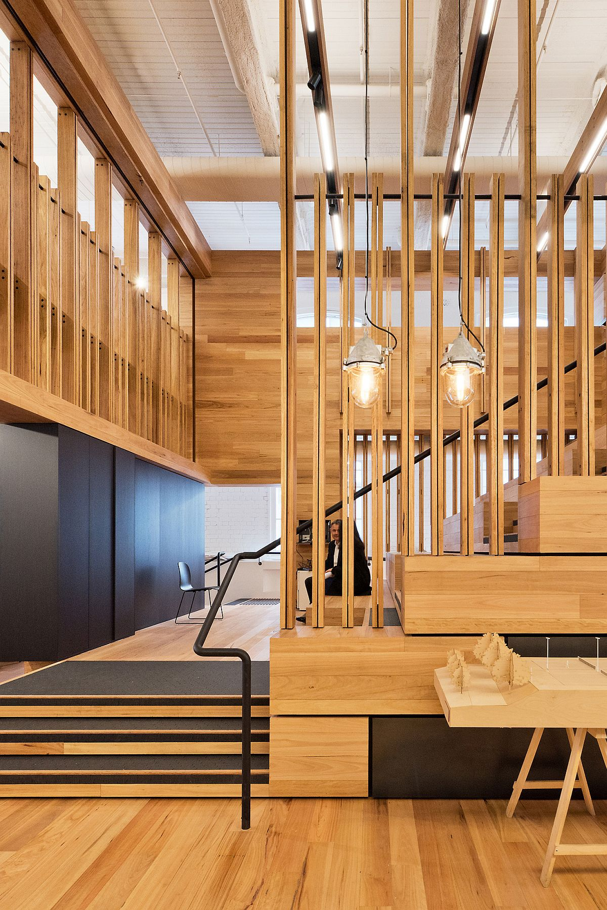 Wooden slats and a high ceiling give the office a modern industrial look