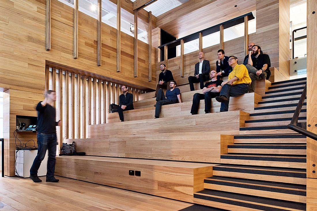 Wooden tiered platforms provide an informal seating zone inside the events space