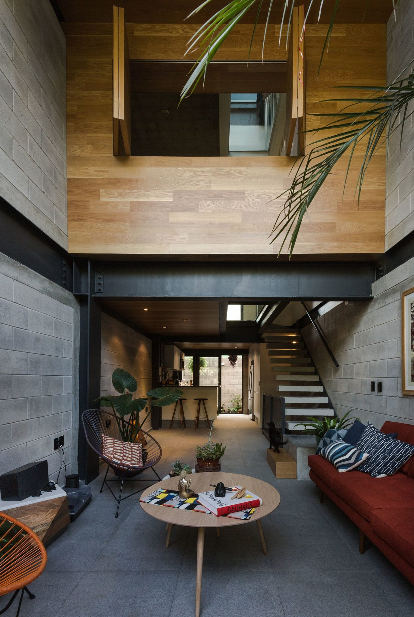Wooden top level of the townhouse with private spaces