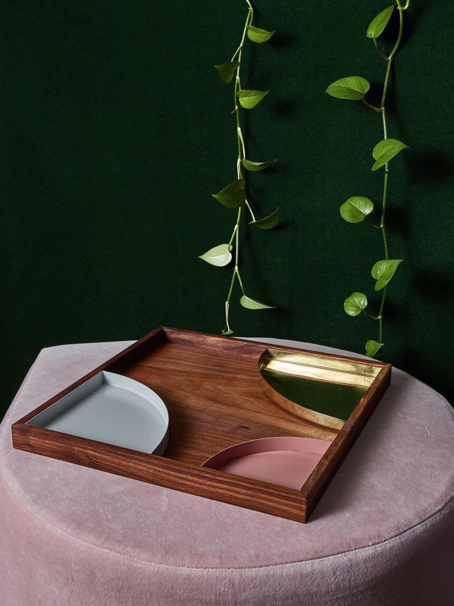 Wooden tray with metal inserts