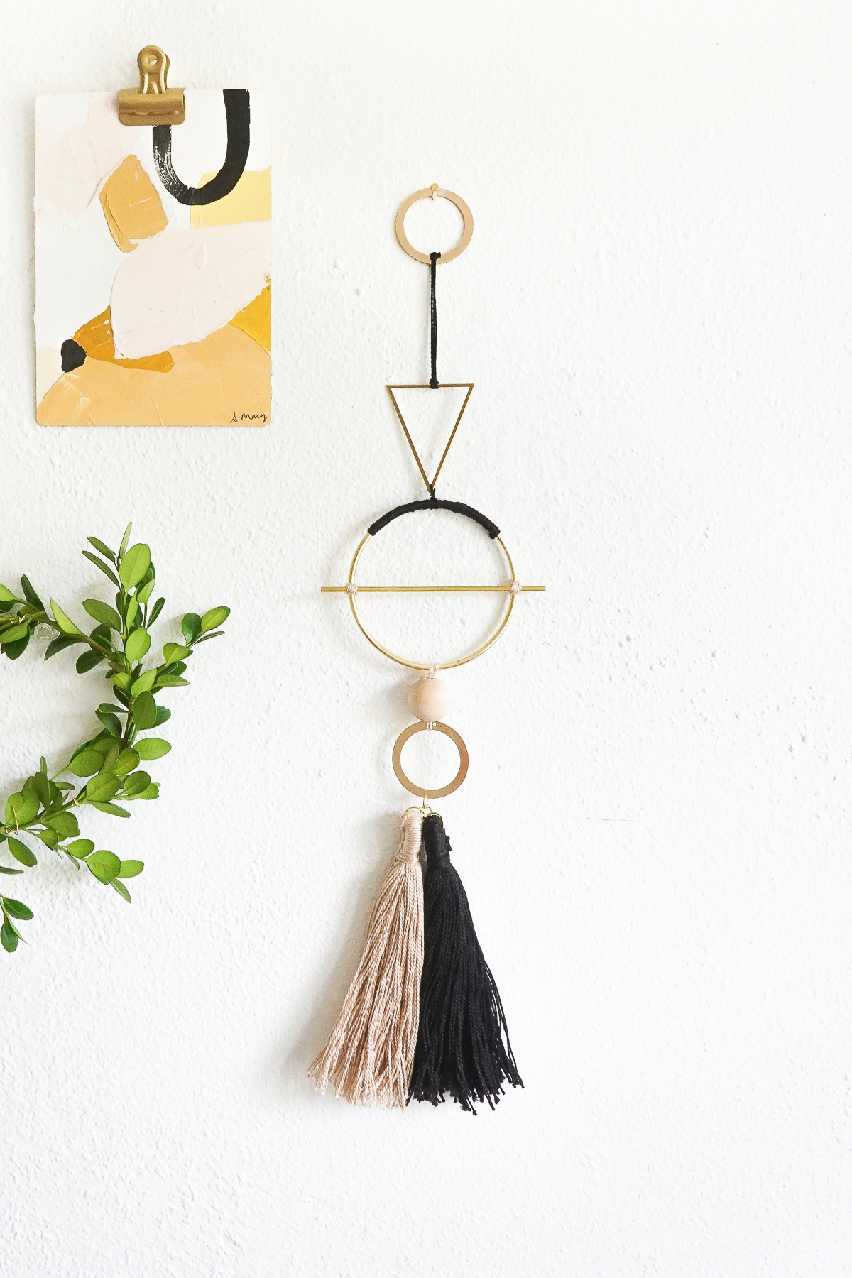 A-geometric-wall-hanging-with-cotton-flossing