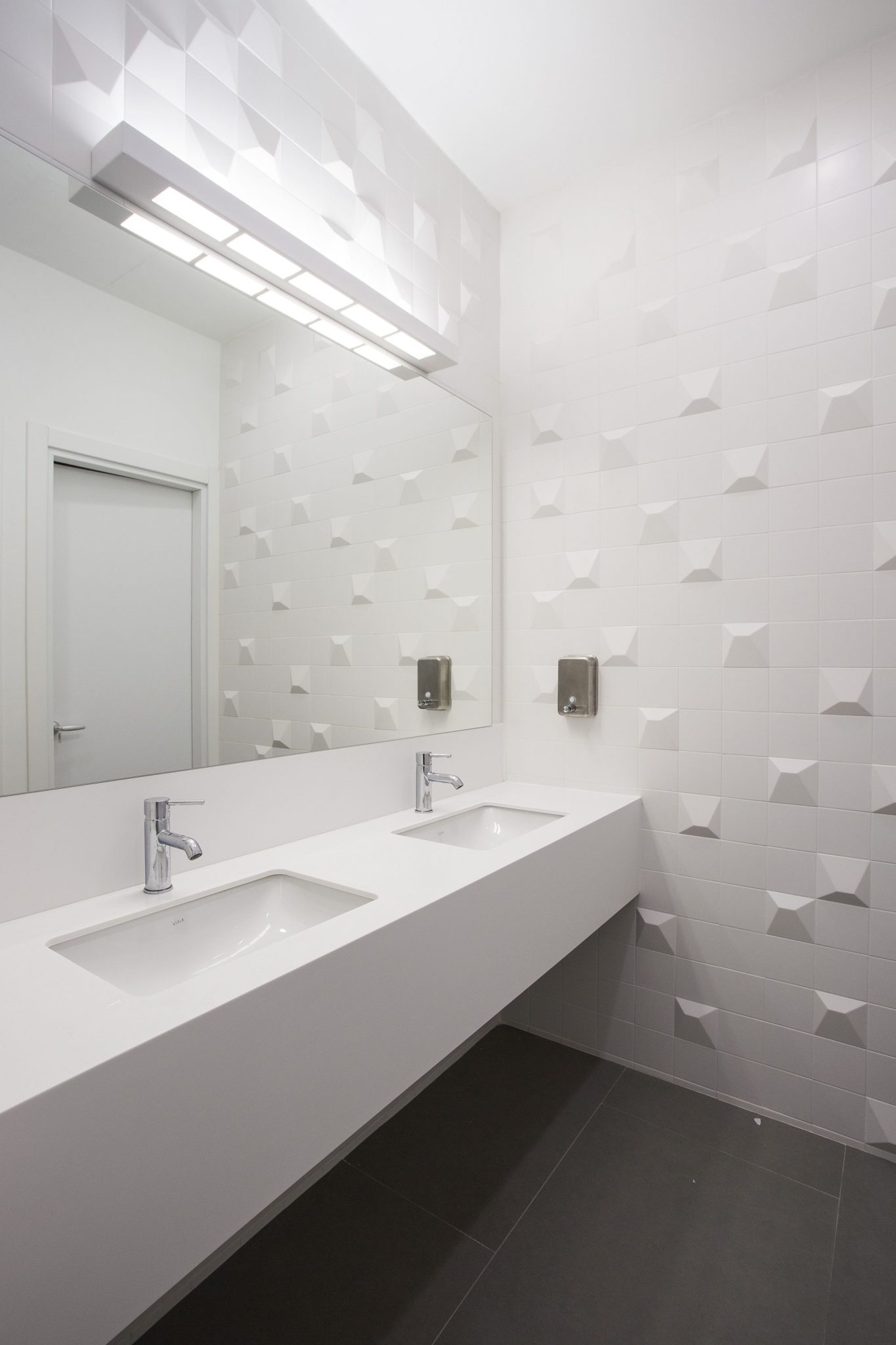 All white bathroom of the office