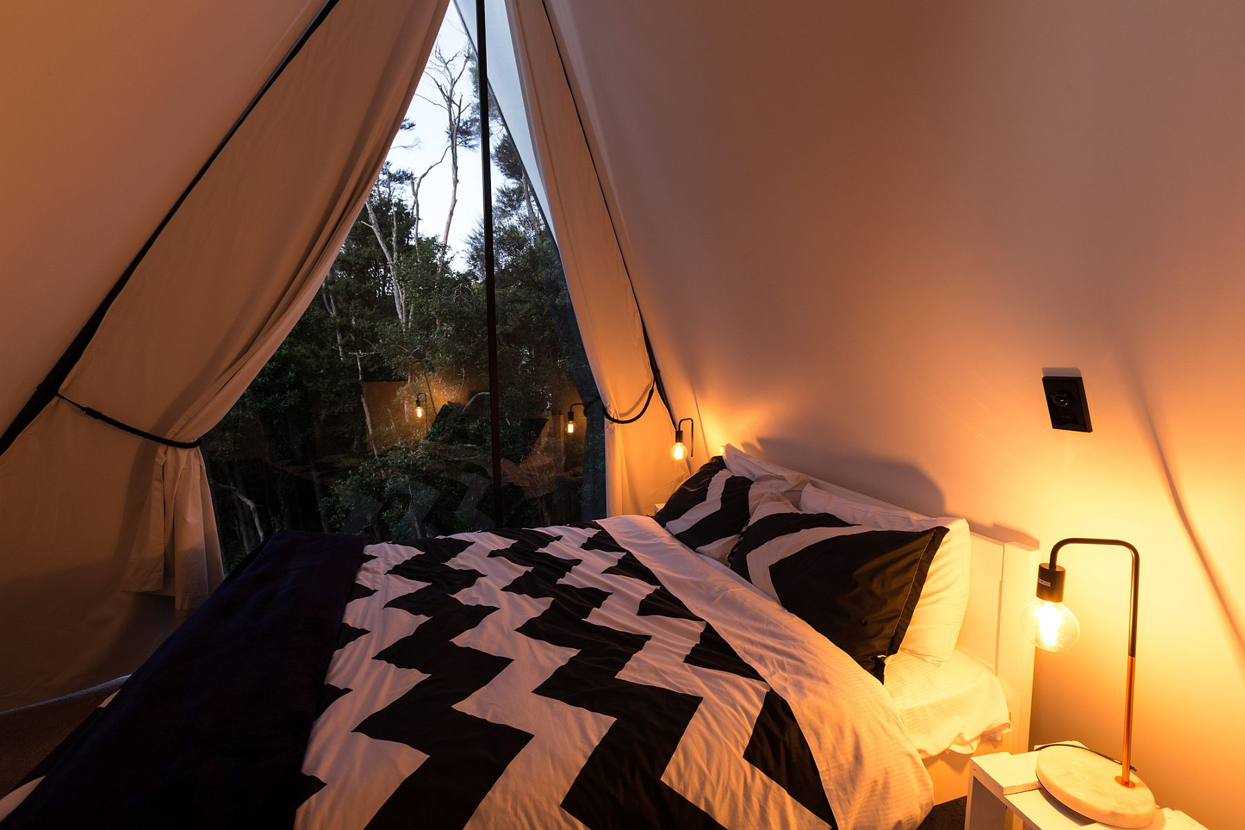 Bedroom on top level with a view of the rainforest canopy