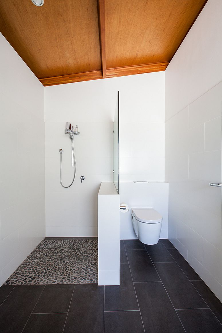 Black-and-white-bathroom-with-sloped-wooden-ceiling