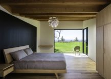 Breezy-modern-bedroom-with-smartly-framed-view-of-the-outdoors-217x155