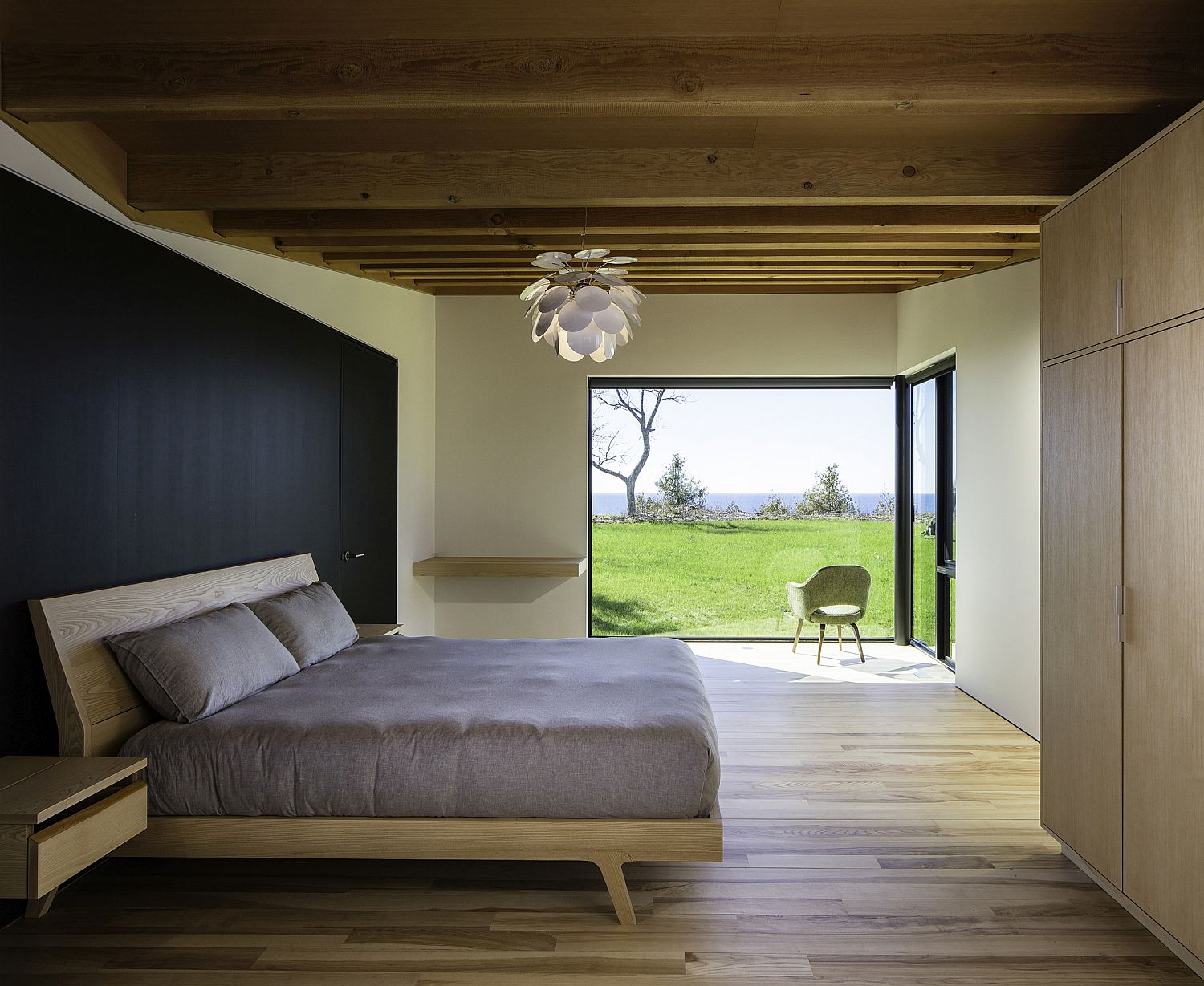 Breezy modern bedroom with smartly framed view of the outdoors
